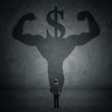 Homem com uma sombra do sinal do atleta e de dólar Fotos de Stock Royalty Free