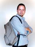 Homem com uma trouxa Fotografia de Stock Royalty Free