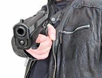 Homem com violência de borracha do ataque da pistola da arma da mão Fotografia de Stock