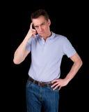 Homem confuso olhando de sobrancelhas franzidas que risca a cabeça no pensamento Foto de Stock