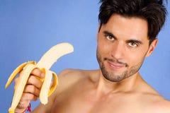 Homem considerável com banana Fotografia de Stock Royalty Free