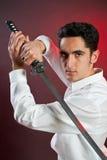 Homem considerável com espada fotos de stock royalty free