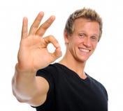 Homem considerável com sinal APROVADO imagem de stock royalty free