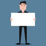 Homem considerável no terno que guarda o cartaz vazio Imagem de Stock