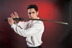 Homem considerável novo com espada. foto de stock