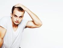 Homem considerável novo no fundo branco que gesticula, apontando, posi Fotografia de Stock Royalty Free