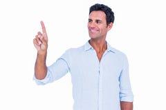 Homem considerável que aponta algo com seu dedo fotografia de stock royalty free