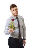Homem considerável que guarda a rosa do vermelho Fotos de Stock