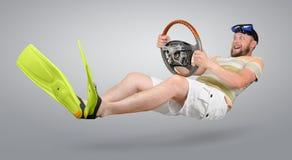 Homem curioso em aletas verdes Imagens de Stock Royalty Free