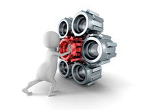 Homem 3d branco que empurra a engrenagem vermelha da roda denteada para o mecanismo Foto de Stock Royalty Free