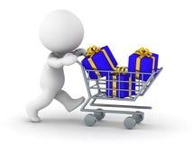 homem 3D com o carrinho de compras com presentes Fotos de Stock Royalty Free