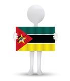 homem 3d pequeno que guarda uma bandeira da república de Moçambique Fotografia de Stock Royalty Free