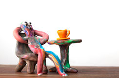 Homem da argila no café Imagens de Stock Royalty Free