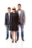 Homem da equipe-dois do negócio e mulher de olhos vendados Imagem de Stock Royalty Free