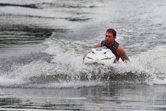 Homem da foto da ação na embarcação de Seadoo Imagens de Stock