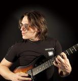 Homem da guitarra Fotografia de Stock