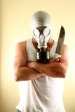 Homem da máscara de gás com faca Foto de Stock Royalty Free