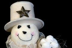 Homem da neve com esferas e chapéu da neve Fotografia de Stock Royalty Free