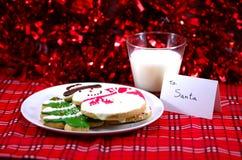 Homem da neve, pão do gengibre, cookie com nota para Santa Fotos de Stock