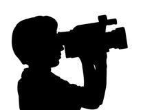 Homem da silhueta com vídeo câmera fotografia de stock