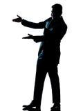 Homem da silhueta que mostra apontando o espaço vazio da cópia Fotografia de Stock Royalty Free