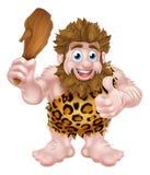 Homem das cavernas dos desenhos animados que dá os polegares acima Foto de Stock Royalty Free