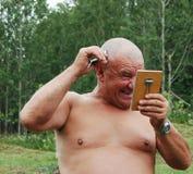 Homem de Barbering fotografia de stock