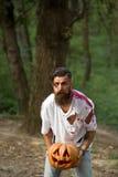 Homem de Dia das Bruxas com abóbora e sangue Imagem de Stock Royalty Free