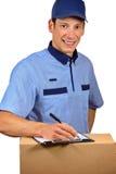 Homem de entrega com sua programação Fotografia de Stock Royalty Free