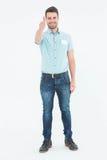 Homem de entrega que gesticula os polegares acima Imagem de Stock Royalty Free