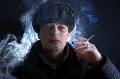 Homem de fumo Imagens de Stock