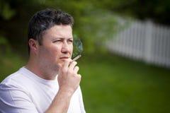 Homem de fumo Imagem de Stock Royalty Free