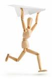 Homem de madeira que funciona com avião de papel Imagens de Stock Royalty Free