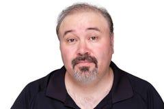 Homem de meia idade cético que aumenta suas sobrancelhas Fotografia de Stock Royalty Free