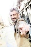 Homem de meia idade considerável que mostra para a câmera foto de stock royalty free