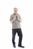 Homem de meia idade que dá os polegares acima fotos de stock royalty free