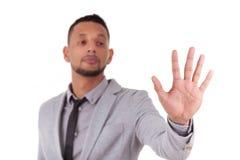 Homem de negócio afro-americano que toca em uma tela transparente - Bl fotografia de stock royalty free