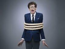Homem de negócio amarrado acima com corda fotos de stock royalty free