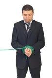 Homem de negócio amarrado corrompido fotografia de stock