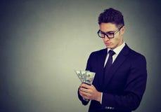 Homem de negócio ambicioso com dinheiro fotos de stock royalty free