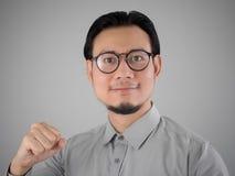 Homem de negócio asiático pronto para ganhar fotografia de stock