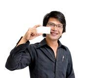 Homem de negócio asiático que mostra o namecard Imagem de Stock Royalty Free