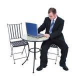 Homem de negócio atrativo no terno com computador Imagem de Stock Royalty Free