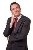 Homem de negócio atrativo no terno com sorrir forçadamente parvo Imagem de Stock
