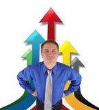 Homem de negócio bem sucedido com setas ascendentes Fotografia de Stock Royalty Free