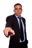Homem de negócio carismático com um telemóvel fotografia de stock royalty free