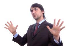 Homem de negócio cauteloso novo Fotografia de Stock Royalty Free