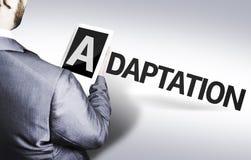 Homem de negócio com a adaptação do texto em uma imagem do conceito imagem de stock
