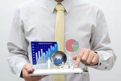 Homem de negócio com almofada de toque Imagem de Stock