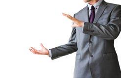 Homem de negócio com as mãos abertas, isoladas no fundo branco Imagens de Stock